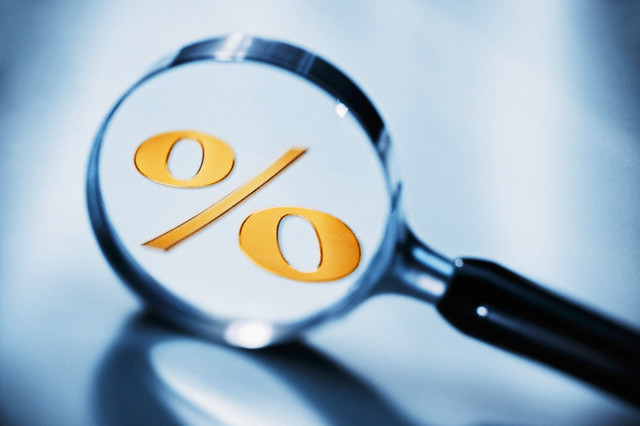 Percent sign in magnifying glass